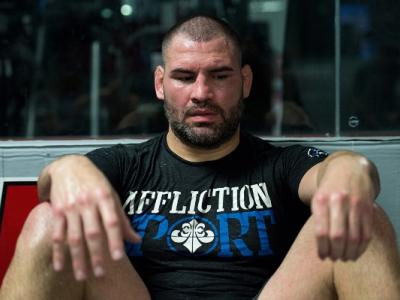 Cain Velasquez rests during an open workout at AKA - Image by Brandon Magnus