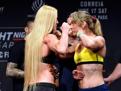 SINGAPORE - JUNE 16:  (L-R) Holly Holm of the United States and Bethe Correia of Brazil face off during the UFC Fight Night weigh-in at the Marina Bay Sands on June 16, 2017 in Singapore. (Photo by Brandon Magnus/Zuffa LLC/Zuffa LLC via Getty Images)