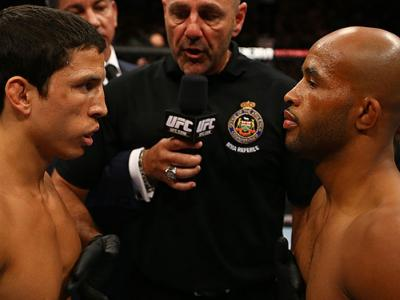 TORONTO, CANADA - SEPTEMBER 22: Opponents Joseph Benavidez (L) and Demetrious Johnson (R) receive final instructions from referee Yves Lavigne before their flyweight championship bout at UFC 152 inside Air Canada Centre on September 22, 2012 in Toronto, O