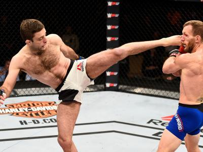 LAS VEGAS, NV - DECEMBER 03: (L-R) Ryan Hall kicks Gray Maynard in their featherweight bout during The Ultimate Fighter Finale event inside the Pearl concert theater at the Palms Resort & Casino on December 3, 2016 in Las Vegas, Nevada. (Photo by Jeff Bot