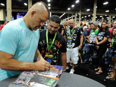 LAS VEGAS, NV - JULY 6:  Former mixed martial artist Chuck Liddell signs autographs for fans during the UFC Fan Expo 2014 during UFC International Fight Week at the Mandalay Bay Convention Center on July 6, 2014 in Las Vegas, Nevada. (Photo by Todd Lussie
