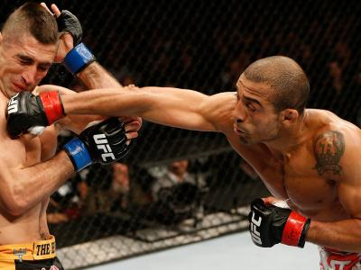 NEWARK, NJ - FEBRUARY 01:  (R-L) Jose Aldo punches Ricardo Lamas in their featherweight championship fight at the UFC 169 event inside the Prudential Center on February 1, 2014 in Newark, New Jersey. (Photo by Josh Hedges/Zuffa LLC/Zuffa LLC via Getty Ima