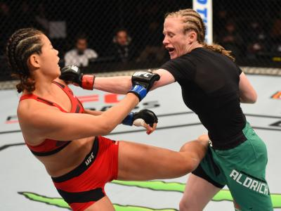 AUCKLAND, NEW ZEALAND - JUNE 11:  (R-L) JJ Aldrich punches Chan-Mi Jeon of South Korea in their women's strawweight fight during the UFC Fight Night event at the Spark Arena on June 11, 2017 in Auckland, New Zealand. (Photo by Josh Hedges/Zuffa LLC/Zuffa