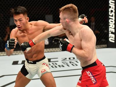 BELFAST, NORTHERN IRELAND - NOVEMBER 19:  (R-L) Brett Johns of Wales punches Kwan Ho Kwak of South Koreain their bantamweight bout during the UFC Fight Night at the SSE Arena on November 19, 2016 in Belfast, Northern Ireland. (Photo by Brandon Magnus/Zuff