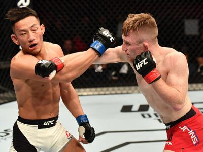 BELFAST, NORTHERN IRELAND - NOVEMBER 19:  (R-L) Brett Johns of Wales punches Kwan Ho Kwak of South Korea in their bantamweight bout during the UFC Fight Night at the SSE Arena on November 19, 2016 in Belfast, Northern Ireland. (Photo by Brandon Magnus/Zuf