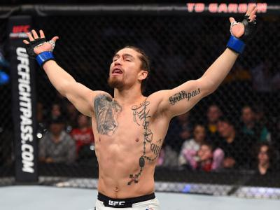 BOSTON, MA - JANUARY 17:  Luke Sanders celebrates after his submission victory over Maximo Blanco in their featherweight bout during the UFC Fight Night event inside TD Garden on January 17, 2016 in Boston, Massachusetts. (Photo by Jeff Bottari/Zuffa LLC/