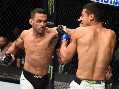 BOSTON, MA - JANUARY 17:  (L-R) Rob Font punches Joey Gomez in their bantamweight bout during the UFC Fight Night event inside TD Garden on January 17, 2016 in Boston, Massachusetts. (Photo by Jeff Bottari/Zuffa LLC/Zuffa LLC via Getty Images)