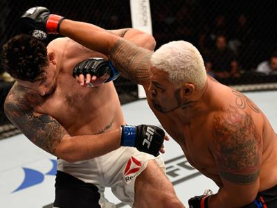 BRISBANE, AUSTRALIA - MARCH 20: (R-L) Mark Hunt of New Zealand punches Frank Mir of the United States in their heavyweight bout during the UFC Fight Night event at the Brisbane Entertainment Centre on March 20, 2016 in Brisbane, Australia. (Photo by Josh