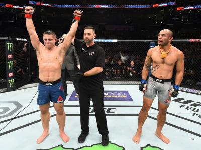 CHARLOTTE, NC - JANUARY 27:   (L-R) Drew Dober celebrates his victory over Frank Camacho of Guam in their lightweight bout during a UFC Fight Night event at Spectrum Center on January 27, 2018 in Charlotte, North Carolina. (Photo by Josh Hedges/Zuffa LLC/