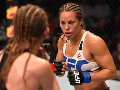 CHICAGO, IL - JULY 25:   (R-L) Elizabeth Phillips battles Jessamyn Duke in their women's bantamweight bout during the UFC event at the United Center on July 25, 2015 in Chicago, Illinois. (Photo by Jeff Bottari/Zuffa LLC/Zuffa LLC via Getty Images)