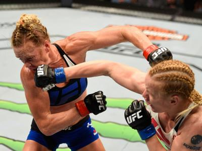 CHICAGO, IL - JULY 23:  (R-L) Valentina Shevchenko of Kyrgyzstan punches Holly Holm in their women's bantamweight bout during the UFC Fight Night event at the United Center on July 23, 2016 in Chicago, Illinois. (Photo by Josh Hedges/Zuffa LLC/Zuffa LLC v