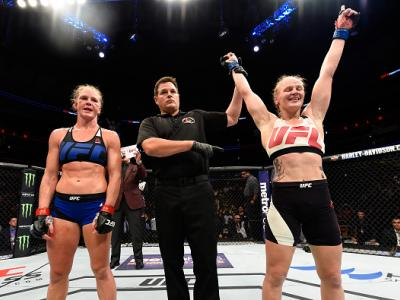 Valentina Shevchenko of Kyrgyzstan celebrates after defeating Holly Holm by unanimous decision in their women's bantamweight bout during the UFC Fight Night event at the United Center on July 23, 2016 in Chicago, Illinois. (P