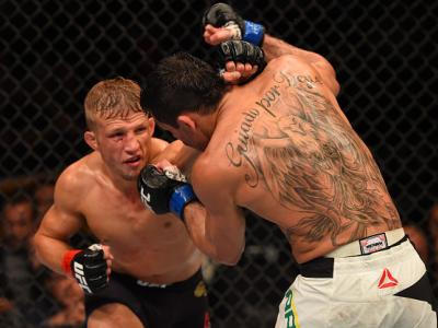 CHICAGO, IL - JULY 25:   (L-R) TJ Dillashaw punches Renan Barao of Brazil in their UFC bantamweight championship bout during the UFC event at the United Center on July 25, 2015 in Chicago, Illinois. (Photo by Jeff Bottari/Zuffa LLC/Zuffa LLC via Getty Ima