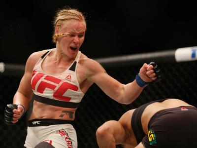 LAS VEGAS, NV - MARCH 05: (L-R) Valentina Shevchenko of Peru punches Amanda Nunes of Brazil in their women's bantamweight bout during the UFC 196 event inside MGM Grand Garden Arena on March 5, 2016 in Las Vegas, Nevada.  (Photo by Christian Petersen/Zuff