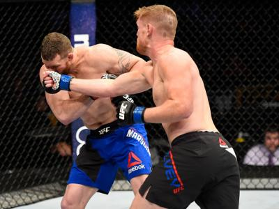 DENVER, CO - JANUARY 28:  (R-L) Sam Alvey punches Nate Marquardt in their middleweight bout during the UFC Fight Night event at the Pepsi Center on January 28, 2017 in Denver, Colorado. (Photo by Josh Hedges/Zuffa LLC/Zuffa LLC via Getty Images)