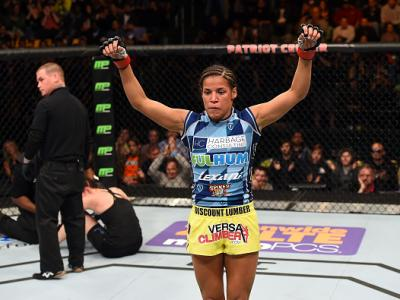 FAIRFAX, VA - APRIL 04:  (R-L) Juliana Pena celebrates after defeating Milana Dudieva in their women's bantamweight fight during the UFC Fight Night event at the Patriot Center on April 4, 2015 in Fairfax, Virginia. (Photo by Josh Hedges/Zuffa LLC/Zuffa L