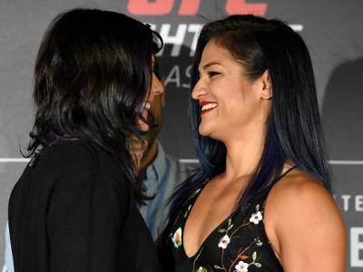 GLASGOW, SCOTLAND - JULY 13:  (L-R) Opponents Joanne Calderwood of Scotland and Cynthia Calvillo face off during the UFC Ultimate Media Day at the Crowne Plaza Glasgow on July 13, 2017 in Glasgow, Scotland. (Photo by Josh Hedges/Zuffa LLC/Zuffa LLC via Ge