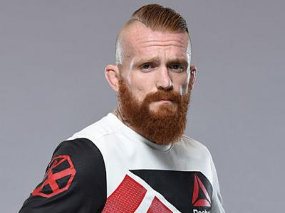 HAMBURG, GERMANY - AUGUST 31:  Jim Wallhead of England poses for a portrait during a UFC photo session at the Radisson Blu, Hamburg on August 31, 2016 in Hamburg, Germany. (Photo by Mike Roach/Zuffa LLC/Zuffa LLC via Getty Images)