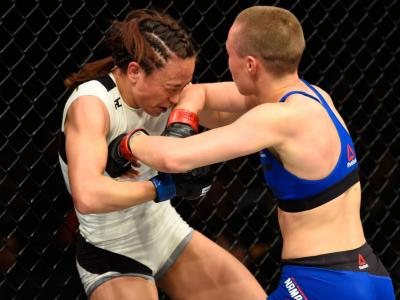 KANSAS CITY, MO - APRIL 15:  (R-L) Rose Namajunas elbows Michelle Waterson in their women's strawweight fight during the UFC Fight Night event at Sprint Center on April 15, 2017 in Kansas City, Missouri. (Photo by Josh Hedges/Zuffa LLC/Zuffa LLC via Getty