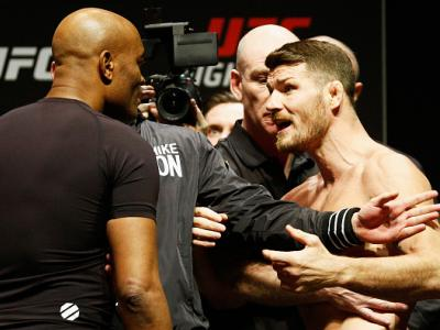 LONDON, ENGLAND - FEBRUARY 26:  Anderson 'The Spider' Silva of Brazil and Michael 'The Count' Bisping of England come face to face and are held back by security during the UFC Fight Night Weigh-in held at at Indigo at The O2 Arena on February 26, 2016 in