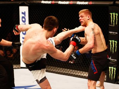 LONDON, ENGLAND - FEBRUARY 27:  Scott Askham of England (L) KO's Chris Dempsey of the USA with a high kick in their Middleweight bout during the UFC Fight Night held at at Indigo at The O2 Arena on February 27, 2016 in London, England.  (Photo by Dean Mou