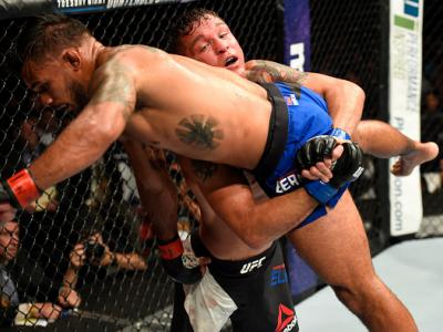 UNIONDALE, NY - JULY 22:  (R-L) Darren Elkins attempts to take down Dennis Bermudez in their featherweight bout during the UFC Fight Night event inside the Nassau Veterans Memorial Coliseum on July 22, 2017 in Uniondale, New York. (Photo by Josh Hedges/Zu