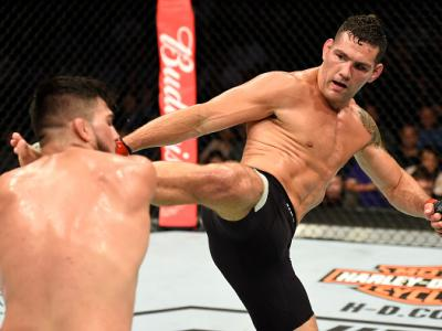 UNIONDALE, NY - JULY 22:  (R-L) Chris Weidman kicks Kelvin Gastelum in their middleweight bout during the UFC Fight Night event inside the Nassau Veterans Memorial Coliseum on July 22, 2017 in Uniondale, New York. (Photo by Josh Hedges/Zuffa LLC/Zuffa LLC