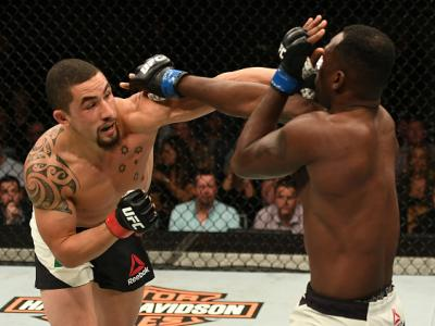 MELBOURNE, AUSTRALIA - NOVEMBER 27:   (L-R) Robert Whittaker of New Zealand punches Derek Brunson in their middleweight bout during the UFC Fight Night event at Rod Laver Arena on November 27, 2016 in Melbourne, Australia. (Photo by Jeff Bottari/Zuffa LLC