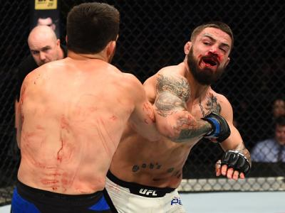 NASHVILLE, TN - APRIL 22:  (R-L) Mike Perry elbows Jake Ellenberger in their welterweight bout during the UFC Fight Night event at Bridgestone Arena on April 22, 2017 in Nashville, Tennessee. (Photo by Jeff Bottari/Zuffa LLC/Zuffa LLC via Getty Images)