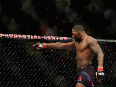 NEWARK, NJ - JANUARY 30:  Anthony Johnson of the United States celebrates his win by TKO against Ryan Bader (not pictured) of the United States in the first round of their light heavyweight bout during the UFC Fight Night event at the Prudential Center o