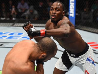 PITTSBURGH, PA - FEBRUARY 21: (R-L) Derek Brunson punches Roan Carneiro in their middleweight bout during the UFC Fight Night event at Consol Energy Center on February 21, 2016 in Pittsburgh, Pennsylvania. (Photo by Jeff Bottari/Zuffa LLC/Zuffa LLC via Ge