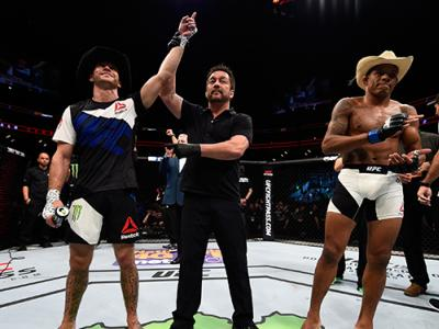PITTSBURGH, PA - FEBRUARY 21: (L-R) Donald Cerrone celebrates his submission victory over Alex Oliveira in their welterweight bout during the UFC Fight Night event at Consol Energy Center on February 21, 2016 in Pittsburgh, Pennsylvania. (Photo by Jeff Bo