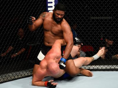 PORTLAND, OR - OCTOBER 01:  (L-R) Curtis Blaydes punches Cody East in their heavyweight bout during the UFC Fight Night event at the Moda Center on October 1, 2016 in Portland, Oregon. (Photo by Josh Hedges/Zuffa LLC/Zuffa LLC via Getty Images)