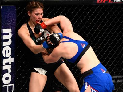 SACRAMENTO, CA - DECEMBER 17:  (R-L) Leslie Smith punches Irene Aldana of Mexico in their women's bantamweight bout during the UFC Fight Night event inside the Golden 1 Center Arena on December 17, 2016 in Sacramento, California. (Photo by Jeff Bottari/Zu