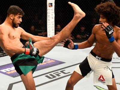 SALT LAKE CITY, UT - AUGUST 06:  (L-R) Yair Rodriguez of Mexico kicks Alex Caceres in their featherweight bout during the UFC Fight Night event at Vivint Smart Home Arena on August 6, 2016 in Salt Lake City, Utah. (Photo by Jeff Bottari/Zuffa LLC/Zuffa LL