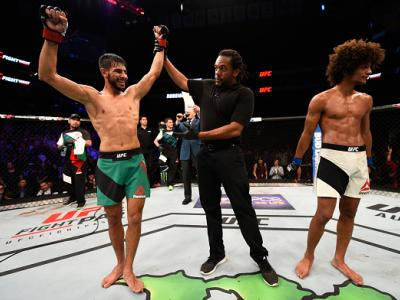 SALT LAKE CITY, UT - AUGUST 06:  (L-R) Yair Rodriguez of Mexico celebrates his victory over Alex Caceres after their featherweight bout during the UFC Fight Night event at Vivint Smart Home Arena on August 6, 2016 in Salt Lake City, Utah. (Photo by Jeff B