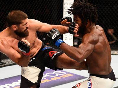 AUGUST 06: (L-R) Court McGee kicks Dominique Steele in their welterweight bout during the UFC Fight Night event at Vivint Smart Home Arena on August 6, 2016 in Salt Lake City, Utah. (Photo by Jeff Bottari/Zuffa LLC/Zuffa LLC via Getty Images)