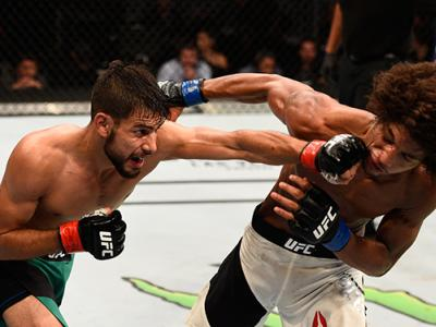 AUGUST 06: (L-R) Yair Rodriguez of Mexico punches Alex Caceres in their featherweight bout during the UFC Fight Night event at Vivint Smart Home Arena on August 6, 2016 in Salt Lake City, Utah. (Photo by Jeff Bottari/Zuffa LLC/Zuffa LLC via Getty Images)