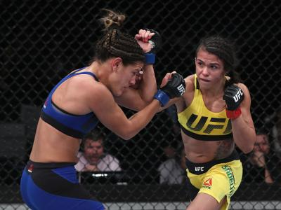 SAO PAULO, BRAZIL - NOVEMBER 19:  Claudia Gadelha of Brazil punches Cortney Casey of the United States during their women's strawweight bout at the UFC Fight Night Bader v Minotouro at Ibirapuera Gymnasium on November 19, 2016 in Sao Paulo, Brazil.  (Phot