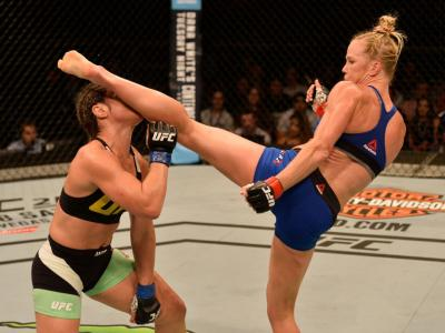 SINGAPORE - JUNE 17:   (R-L) Holly Holm knocks out Bethe Correia of Brazil with a kick in their women's bantamweight bout during the UFC Fight Night event at the Singapore Indoor Stadium on June 17, 2017 in Singapore. (Photo by Brandon Magnus/Zuffa LLC/Zu