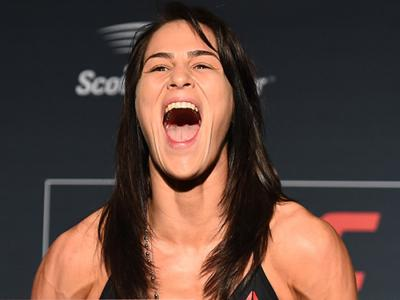 ST. LOUIS, MO - JANUARY 13:  Jessica Eye poses on the scale during the UFC Fight Night weigh-in on January 13, 2018 in St. Louis, Missouri. (Photo by Josh Hedges/Zuffa LLC/Zuffa LLC via Getty Images)