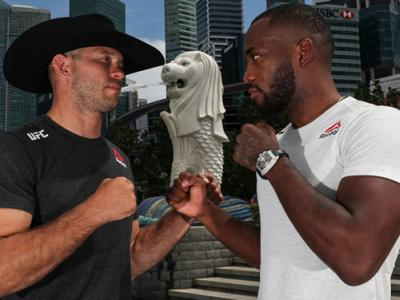 SINGAPORE, SINGAPORE - APRIL 25: Donald Cerrone (L) and Leon Edwards pose for a photo at the Merlion Park, overlooking the financial district, on April 25, 2018 in Singapore. (Photo by Yong Teck Lim/Zuffa LLC)
