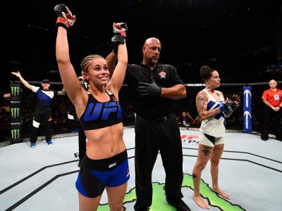 VANCOUVER, BC - AUGUST 27:  (L-R) Paige VanZant of the United States celebrates her knockout victory over Bec Rawlings of Australia in their women's strawweight bout during the UFC Fight Night event at Rogers Arena on August 27, 2016 in Vancouver, British