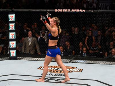 VANCOUVER, BC - AUGUST 27:  Paige VanZant of the United States celebrates her knockout victory over Bec Rawlings of Australia in their women's strawweight bout during the UFC Fight Night event at Rogers Arena on August 27, 2016 in Vancouver, British Colum