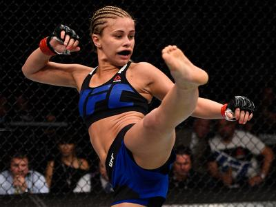 VANCOUVER, BC - AUGUST 27:  Paige VanZant of the United States kicks Bec Rawlings of Australia in their women's strawweight bout during the UFC Fight Night event at Rogers Arena on August 27, 2016 in Vancouver, British Columbia, Canada. (Photo by Jeff Bot