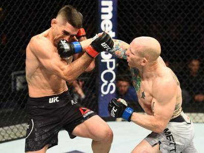 WINNIPEG, CANADA - DECEMBER 16:  (R-L) Josh Emmett punches Ricardo Lamas in their featherweight bout during the UFC Fight Night event at Bell MTS Place on December 16, 2017 in Winnipeg, Manitoba, Canada. (Photo by Josh Hedges/Zuffa LLC/Zuffa LLC via Getty