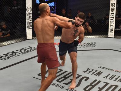 LAS VEGAS, NV - JUNE 19:  (R-L) Matt Sayles punches Yazan Hajeh of Palestine in their featherweight bout during Dana White's Tuesday Night Contender Series at the TUF Gym on June 19, 2018 in Las Vegas, Nevada. (Photo by Elliott Howard/DWTNCS LLC)