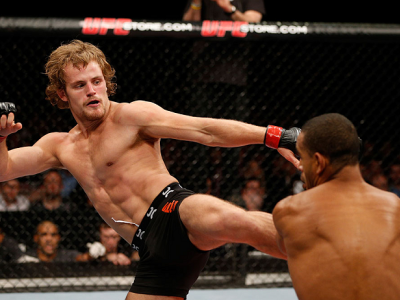LONDON, ENGLAND - FEBRUARY 16:  (L-R) Gunnar Nelson kicks Jorge Santiago in their welterweight fight during the UFC on Fuel TV event on February 16, 2013 at Wembley Arena in London, England.  (Photo by Josh Hedges/Zuffa LLC/Zuffa LLC via Getty Images)