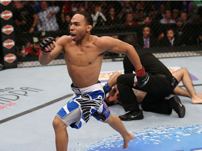 HOUSTON, TEXAS - OCTOBER 19:  (L-R) John Dodson runs to the side of the Octagon after defeating Darrell Montague by knockout in their UFC flyweight bout at the Toyota Center on October 19, 2013 in Houston, Texas. (Photo by Nick Laham/Zuffa LLC/Zuffa LLC v