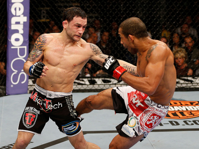 LAS VEGAS, NV - FEBRUARY 02:  (L-R) Frankie Edgar punches Jose Aldo during their featherweight title fight at UFC 156 on February 2, 2013 at the Mandalay Bay Events Center in Las Vegas, Nevada.  (Photo by Josh Hedges/Zuffa LLC/Zuffa LLC via Getty Images)